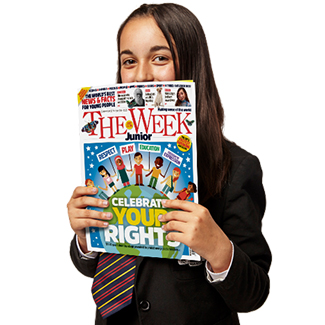 Child holding The Week Junior magazine